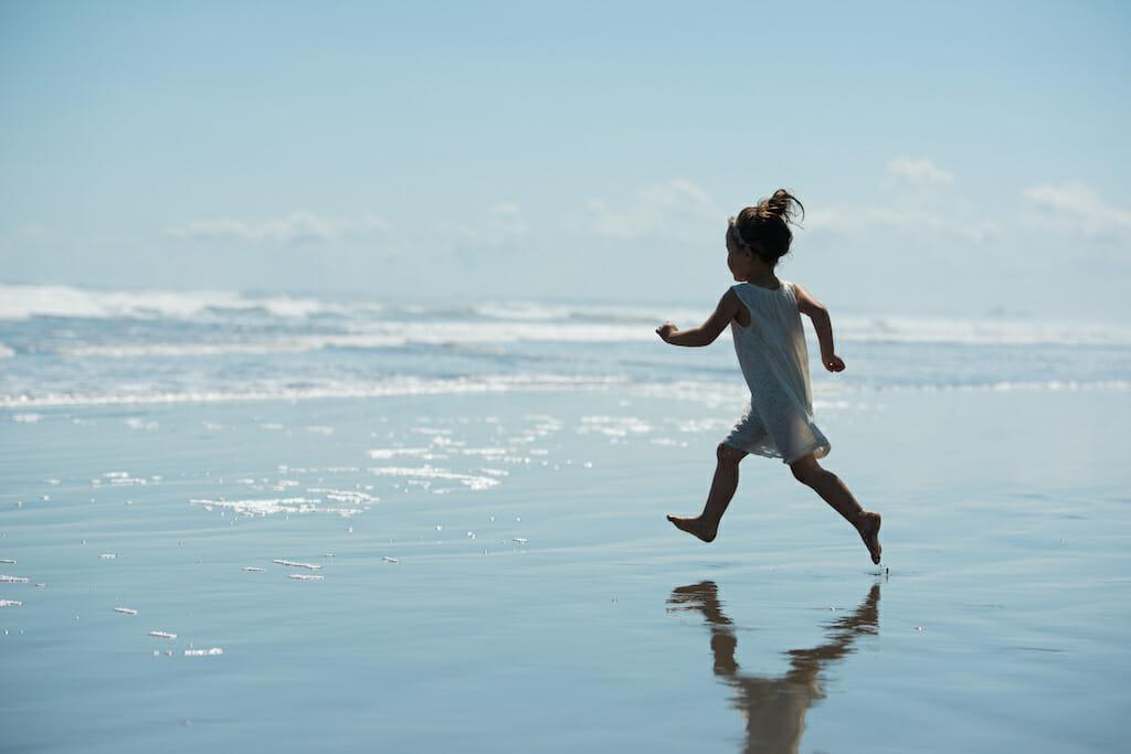 girl-running-into-sea