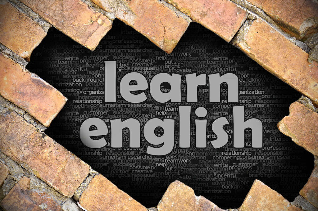 The hole in the brick wall with word learn english
